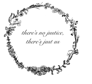 "Blumenkranz mit einer Phrase in der Mitte/ Wreath of flowers with the following words in the center: ""There's no justice, there's just us"""